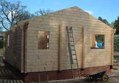 Building log cabin kits in the garden