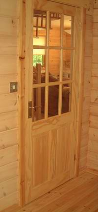 You can use glass in log cabin internal doors to increase natural light