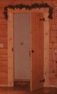 More rustic log cabin doors with iron hinges and handles can look good
