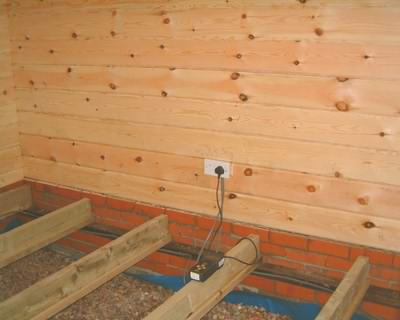 log cabin foundation with timber joists