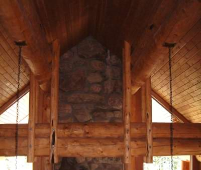 Timber and stone are often used for log cabin interior finishes in North America