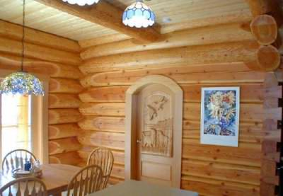 Logs provide wonderful log cabin interior finishes