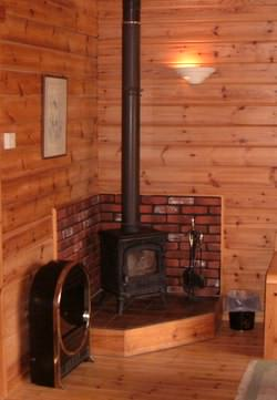 Which materials help keep your log cabin interior costs down?