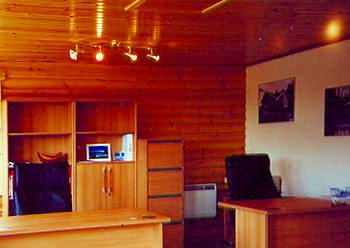 Timber and plaster can work well on log cabin internal walls