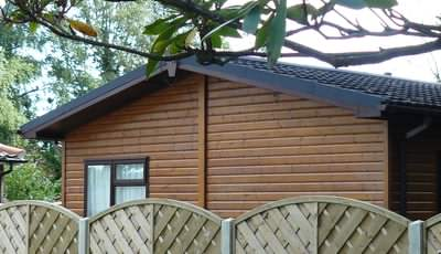 Many mobile log cabins holiday chalets have plastic, fake wood exteriors