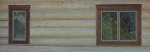 Windows in a hand scribed North American log cabin