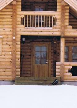Lots of Scandinavian log cabins have a covered entrance area