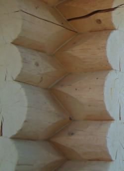Solid log corner joint for log cabins Canada